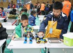 """首届重庆市青少年""""人工智能--机器人""""创新挑战赛成功举行"""